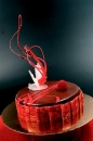Red Mirror glaze as a cake